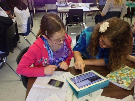 Two students work on trying to find a topic for their next Genius Hour project.