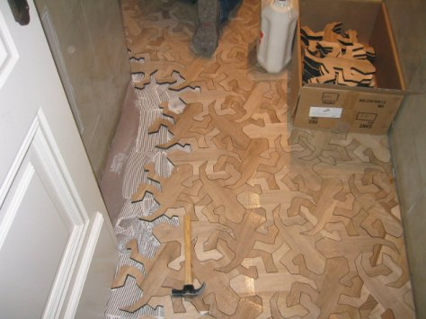 from http://geekologie.com/2013/05/mc-escher-inspired-interlocking-wooden-f.php