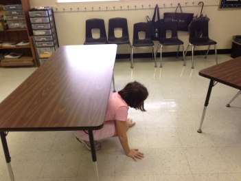 One of my students follows instructions for navigating the obstacle course.