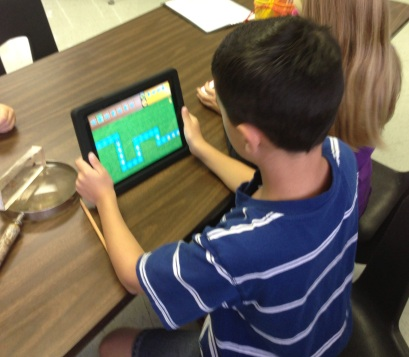 A couple of my 2nd graders as they play with the Kodable app.