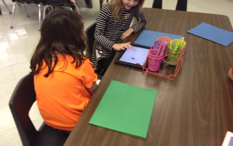 Two girls work on the Hopscotch app in my classroom